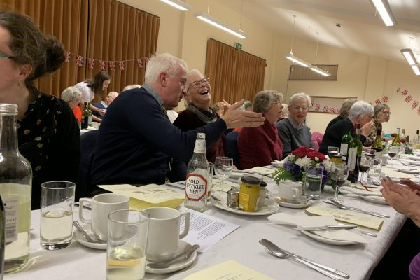 Two villagers share a laugh at the recreation dinner